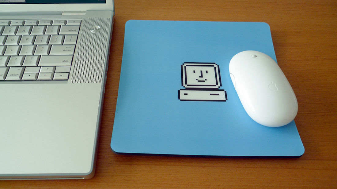 A blue mousepad showing the apple startup icon