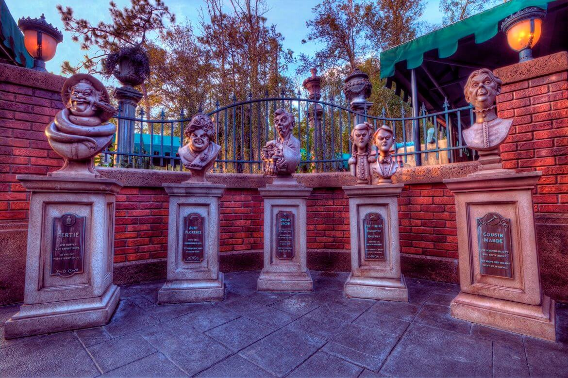 Five busts outside of the Haunted Mansion at Disneyland