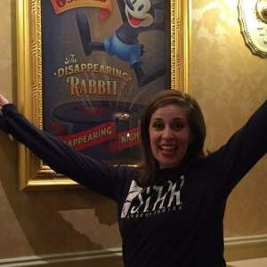 Women excited by poster at Disneyland