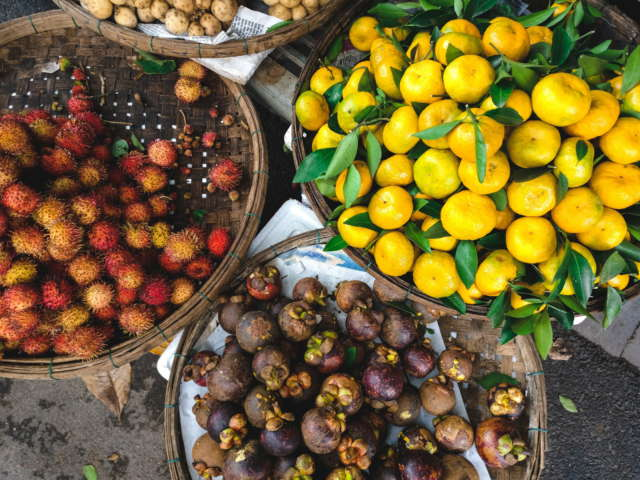 Mangosteens and mandarin oranges at the market