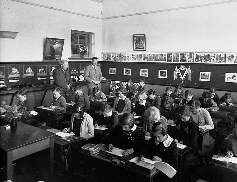 Students in a classroom at desks working.